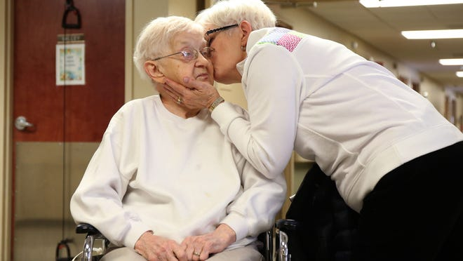 Priscilla Myers of Johnston kisses her mother, Rosemary Hall, on the cheek before leaving the Bishop Drumm Retirement Center in Johnston on Thursday. Hall, 96, recently recovered from the flu outbreak that infected many care center residents.