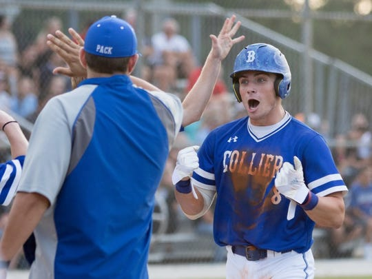 Barron Collier's Marc Coffers (8) celebrates with his teammates after scoring the first run against Dunedin during the FHSAA Regional Final baseball game at Barron Collier High School on Tuesday, May 10, 2016. (Photo by Gregg Pachkowski / Special to the Daily News)