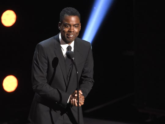 "Actor-comedian Chris Rock took verbal jabs at Jussie Smollett before he presented outstanding comedy series to ABC's ""black-ish."""