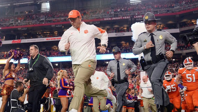Dabo Swinney leads Clemson onto the field.