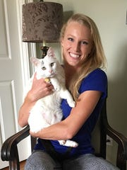 Olympic pole vaulter Sandi Morris with her cat Rio at her parent's home in Piedmont on Saturday, July 30, 2016.