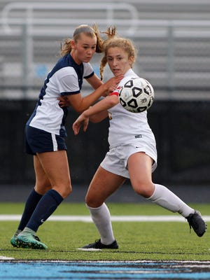 DeWitt's Danielle Stephan, right, and Grand Ledge's Cassidy Pettinger battle for the ball in the Gold Cup final, Tuesday, May 23, 2017, in Lansing, Mich.