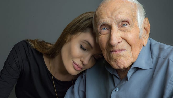 Angelina Jolie with Louis Zamperini, the subject of her next movie, 'Unbroken.' He died on July 2.