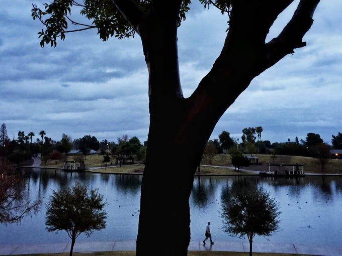 After a night of rain, a walker enjoys a cool morning