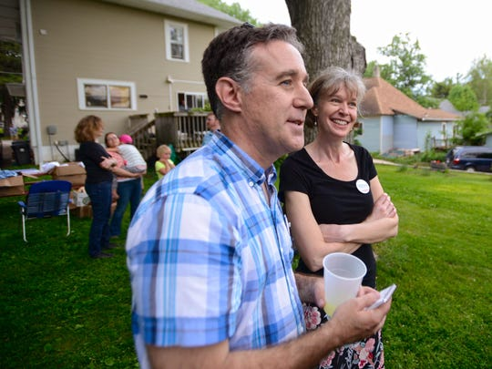 Dave Johnson and Jennie Embree stand in their backyard as more than 175 wait there to hear Sen. Bernie Sanders on Friday night.