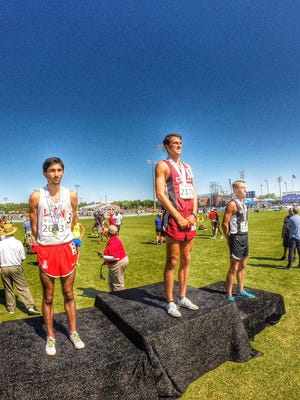 Chiles senior Avery Bartlett takes the podium after winning the mile over Leon's Sukhi Khosla during Saturday's FHSAA Class 3A state meet. Bartlett also won the 800, leading Chiles to back-to-back 3A state championships.