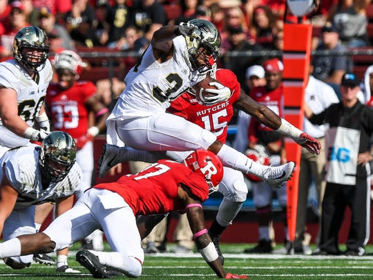 Oct 21, 2017; Piscataway, NJ, USA; Purdue Boilermakers running back Richie Worship (34) leaps over Rutgers Scarlet Knights defensive back K.J. Gray (17) in the third quarter at High Point Solutions Stadium. Mandatory Credit: Dennis Schneidler-USA TODAY Sports
