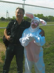 Ron Erdrich, of the Abilene Reporter-News, meets with Carolyn Atkins, as the Easter Bunny, at the HoneyBees Extension Education Club's annual Easter egg hunt in Lawn.