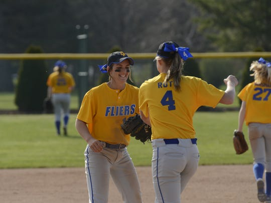The Clyde softball team smiles after making an out in a game against Margaretta last season.