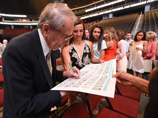 Charlie McGill, who has been an illustrator for The Record since 1954, signs autographs of his Athlete of the Week drawings during the NorthJersey.com  Sports Award at Prudential Center, Newark, on Wednesday, June 14, 2017.