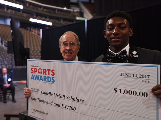 Record illustrator Charlie McGill, left, with McGill Scholarship Award recipient  Dayvon Robinson,. of Kennedy, on Wednesday, June 14, 2017 at Prudential Center, Newark, during the NorthJersey.com Sports Awards.