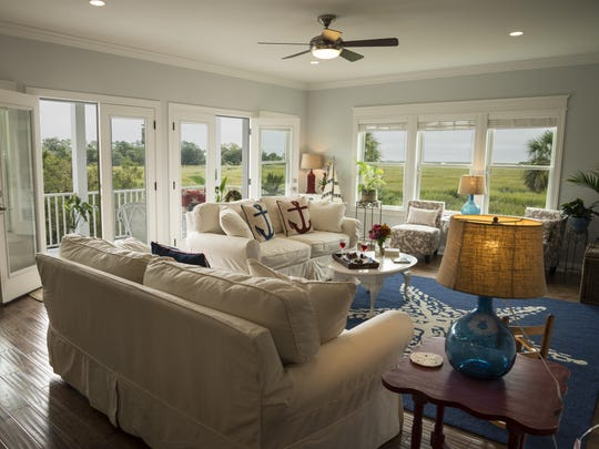 The living room at Blue Heron Inn is comfortable with beautiful views.
