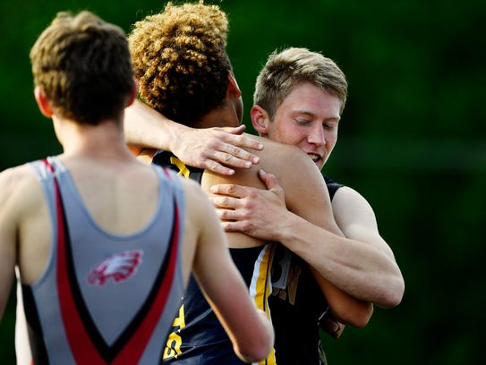 Red Lion's Kaden Smith, far right, greets Eastern York's