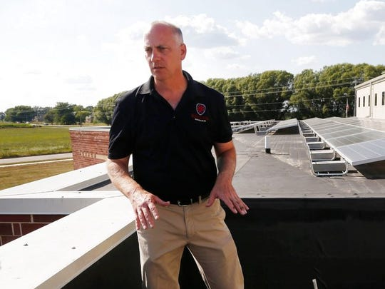 In this Aug. 12, 2017, photo, Terry Dvorak, CEO of Red Lion Renewables, talks about the 206 solar panels his company installed on the roof of St. John the Apostle Catholic Church in Norwalk, Iowa. Church leaders in central Iowa are turning to solar power for their buildings in an effort to aid the environment and save money.