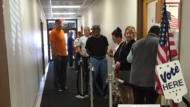 Voters wait in line to vote Oct. 12 at the Licking County Board of Elections office. It was the first day of early voting.
