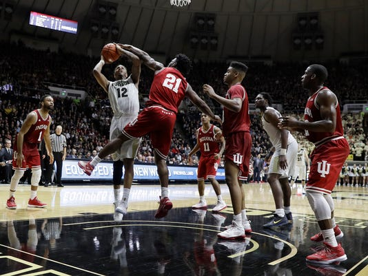 Purdue's Vince Edwards puts up a shot against Indiana's Freddie McSwain Jr. (21) during the second half of an NCAA college basketball game Tuesday, Feb. 28, 2017, in West Lafayette, Ind. Purdue defeated Indiana 86-75. (AP Photo/Darron Cummings)