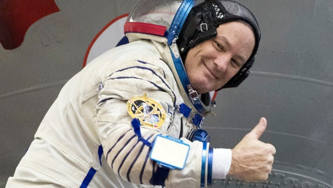 U.S. astronaut Scott Tingle give the thumbs up after his final preflight practical examination in a mock-up of a Soyuz space craft at Russian Space Training Center in Star City, outside Moscow, Russia, Wednesday, Nov. 29, 2017. Russian cosmonaut Anton Shkaplerov, U.S. astronaut Scott Tingle, and Japanese astronaut Norishige Kanai are the next crew scheduled to blast off to the International Space Station from the Baikonur Cosmodrome on a Russian made Soyuz Soyuz MS-07 space craft. (AP Photo/Pavel Golovkin)