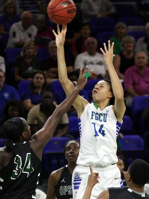 FGCU's Whitney Knight scores against USC Upstate on Thursday at Alico Arena in Fort Myers.