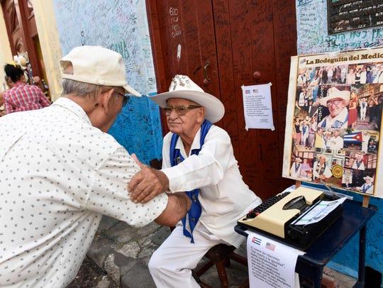 Havana poet Orlando LaGuardia at his small street stand