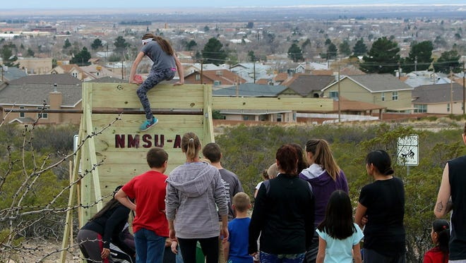 Attendees participate in an obstacle course during New Mexico State University-Alamogordo's second annual Health and Wellness Fair on Saturday. An estimated 200 people participated in the event.