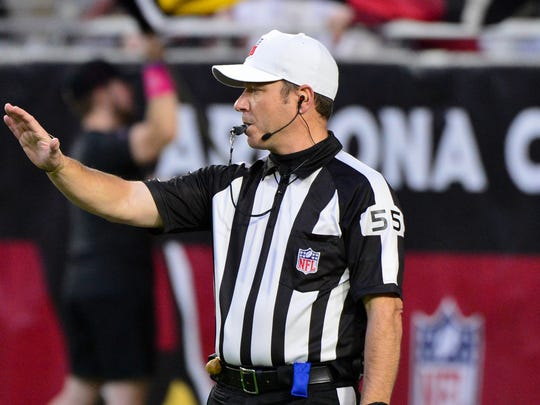 Oct 18, 2018; Glendale, AZ, USA; NFL side judge Alex Kemp (55) signals during the first half of the game between the Arizona Cardinals and the Denver Broncos at State Farm Stadium. Mandatory Credit: Matt Kartozian-USA TODAY Sports
