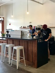 Baristas hard at work at Horizon Line Coffee in Des