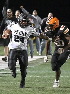 Perry running back Josh Lemon has everyone chasing him as he runs for a first down against Hoover, Oct. 4,2019.