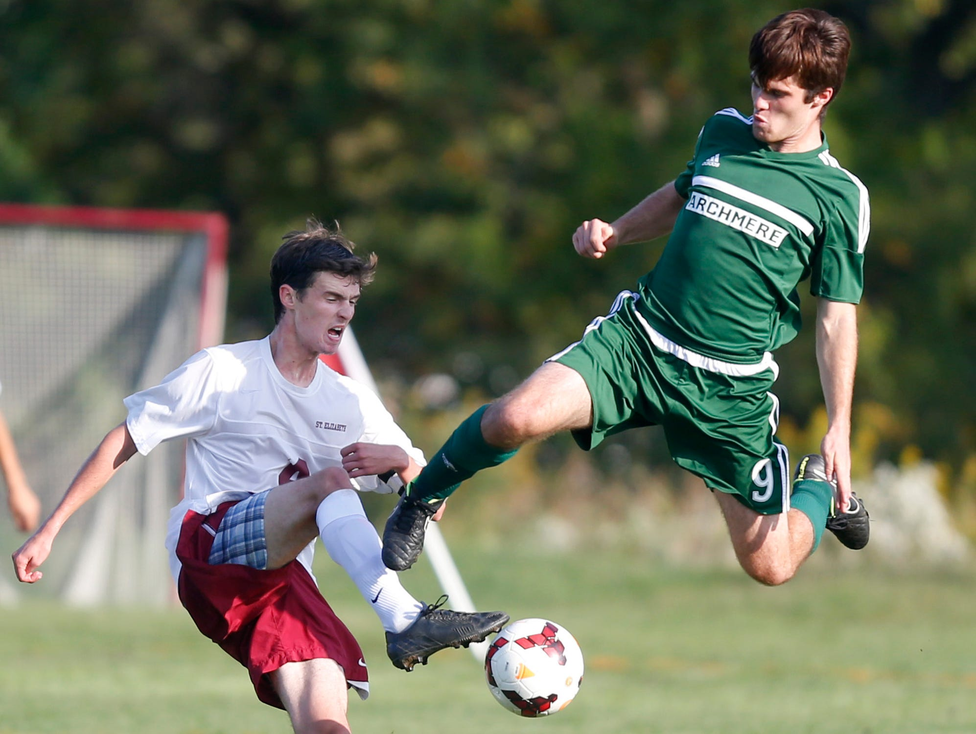 Archmere's Joe McAlonan keeps in the air while going for a ball with St. Elizabeth's Alex Hantman in the first half of Archmere's 2-1 win at Alapocas Run State Park Tuesday.