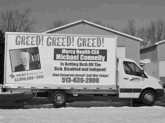 "A photograph of the mobile billboard is included in court documents filed by Michael Connelly in his lawsuit against a labor union. The photo is listed as ""Exhibit A."""