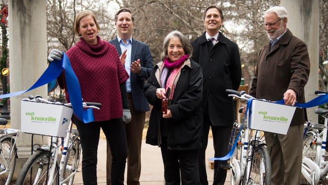 Knoxville Mayor Madeline Rogero cuts the ribbon for the city's new Pace bike sharing program in downtown Knoxville on Thursday, February 1, 2018.