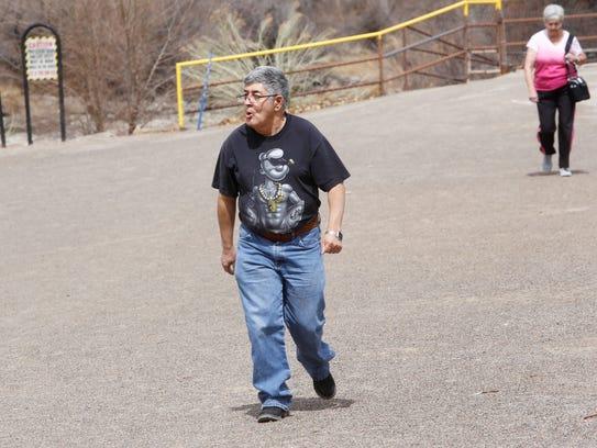 Jose Chavez of Farmington walks down an Animas Park