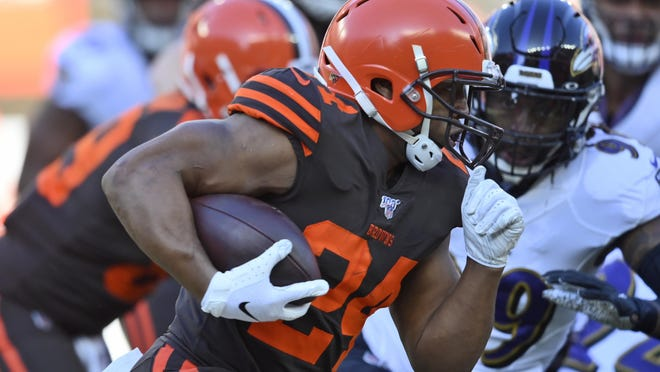 Browns running back Nick Chubb rushes during the first half of a game against  the Baltimore Ravens last season in Cleveland.