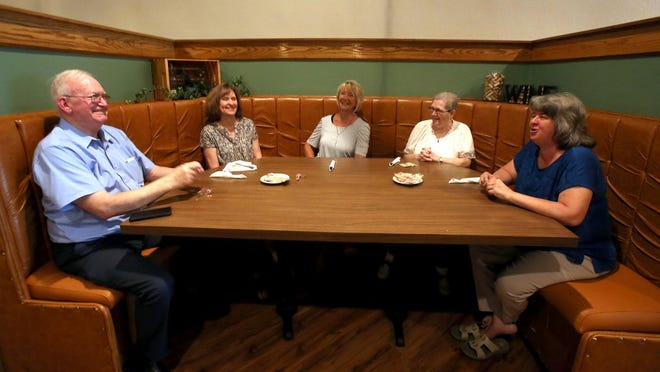 From left, Glenn walker, Rita Scism, Jane Falls, Ruth Williams and Tammy Green enjoy a lunch break from Laura's Homes at Toscanos Bistro in uptown Shelby on Tuesday.