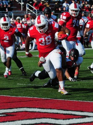 Olivet College running back Jerome Washington (38).