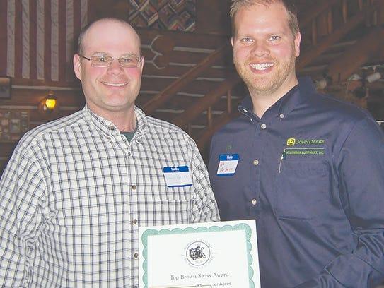 Rob Van Harten (Greenmark Equipment) with Casey Sparks—Top