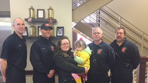 """Just two weeks ago """"Charlie"""", as she is called by her family, was choking on some food when caregivers called 911. Wauwatosa Fire Department helped save the girl. She visited the fire department to say thanks on April 18.  Firefighter/Paramedic Nate Reisdorf Firefighter/Paramedic Ryan Stanwood, Captain Dave Page, Heavy Equipment Operator Phil Klass and Charisse Vanslett  and Carlie.   Firefighter Mark Jodarski (not pictured)"""