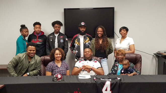 Asheville High senior DeAndre Gaskin has signed to play college football for Mars Hill.