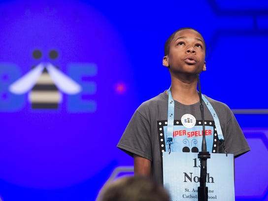 Noah Dooley, 13, from Silver Spring, Md., spells his