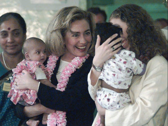 Hillary and Chelsea Clinton hold orphaned babies during