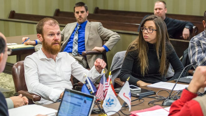Drury alumnus Shawn Billings (left) and current student Shae Dunaway are two of the staffers with the Veterans Treatment Court in the 39th Judicial Circuit, which helps veteran offenders overcome addiction and mental health issues.