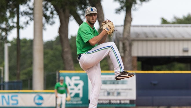 University of West Florida pitcher Dylan Mills-Derouen winds up to throw against Auburn-Montgomery last Friday in Pensacola.