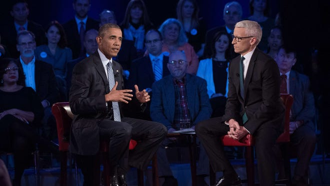 President Obama speaks at a town hall meeting with CNN's Anderson Cooper on reducing gun violence at George Mason University in Fairfax, Virginia, Thursday.