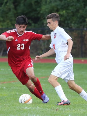 Horace Greeley's Ben Cannon (24) tries to steal the ball from Fox Lane's Eric Discua (23) during game action at Horace Greeley High school in Chappaqua on Sept. 7, 3016. Horace Greeley defeats Fox Lane 3-2.