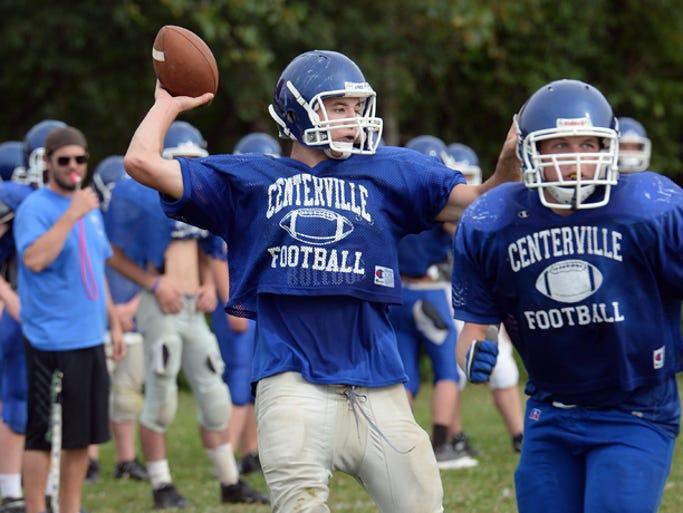 Centerville High School Football quarterback Austin Mavity throws a pass during practice Thursday, Aug. 7, 2014.