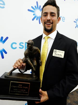 "Southern Mississippi junior right-handed pitcher Nick Sandlin holds the Ferriss Trophy as the state's top collegiate baseball player, Monday, May 21, 2018, in Jackson, Miss. The trophy is named in honor of Dave ""Boo"" Ferriss, who spent 46 years in college and pro baseball and won 639 games as the Delta State University's head coach and won 46 games his first two years in the majors and is a part of the Boston Red Sox Hall of Fame. (AP Photo/Rogelio V. Solis)"