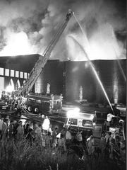 Crews battle the deadly blaze at the Beverly Hills Supper Club in 1977.