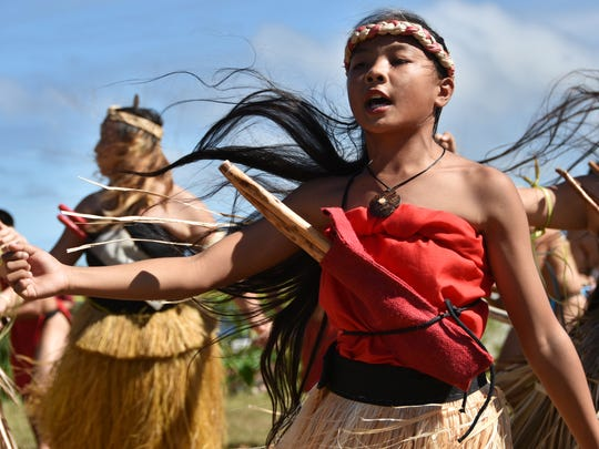 This image from a dance performance at the annual Chamorro Lunar Calendar Festival held on Jan. 17, was a favorite, with the wind kicking up the dancers' hair, creating drama. The side lighting and the girl's expression also add a sense of permanence within motion, a steeliness in fluidity.