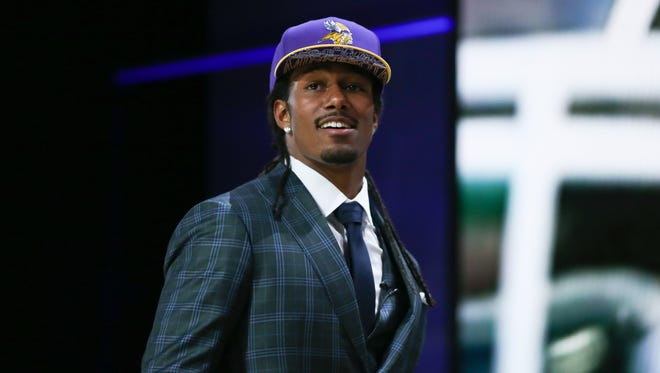 Trae Waynes of the Michigan State Spartans walks on stage after being picked #11 overall by the Minnesota Vikings during the first round of the 2015 NFL Draft at the Auditorium Theatre of Roosevelt University on April 30, 2015 in Chicago.