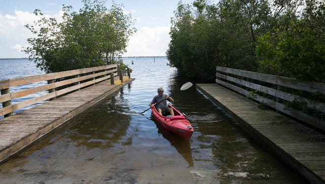 """""""It's all I can do to get down here,"""" said James Sizelove, of Fort Pierce, after traveling to the Oslo Boat Ramp in Vero Beach on Nov. 5, 2017, to go kayaking. The road leading to the boat ramp is uneven and has many large holes with deep puddles, making it difficult for some cars to make it to the water."""