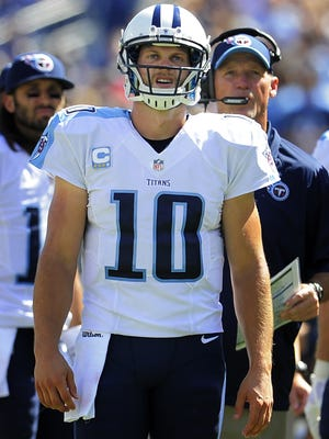 Titans quarterback Jake Locker and coach Ken Whisenhunt check the scoreboard during a 26-10 loss to the Cowboys at LP Field on Sunday.